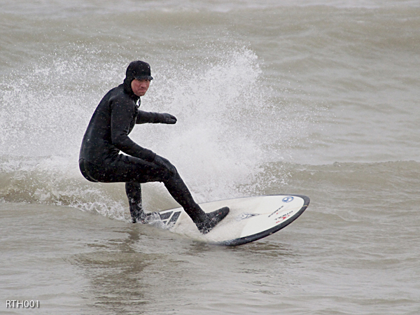 Wild winter waves: Rob DoBias surfs Lake Ontario during one of Toronto's many snowfalls earlier this month.