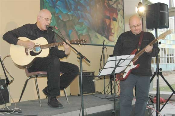 Centennial College staffers Chris Terry (left) and Steve Starr perform at the East York campus' White Ribbon fundraiser, held on Dec. 3.