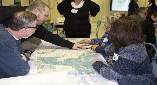 Workshop participants work together to locate areas  they think need to become more eco friendly