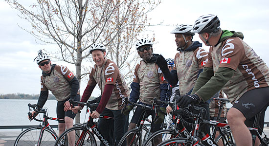 Defence Minister Peter MacKay (second from left) joins a contingent of Canadian veterans, including Capt. Mark Chamberlain (far left) and Sgt. Eric Jenkinson (far right), during a recent training ride along Toronto's waterfront. On May 20, the team, sponsored by Wounded Warriors, is set to join 'Help for Heroes' in Portsmouth, England, for a bike tour to historic battlefields in France and Belgium. It's known as the 'Big Battlefield Bike Ride.'