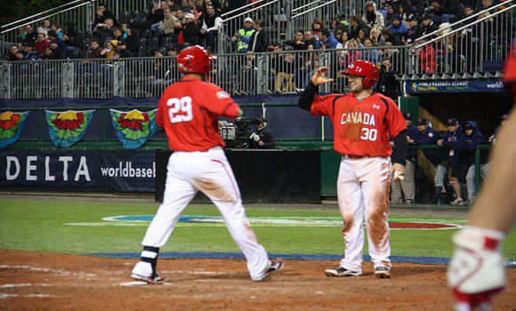 #29 Jimmy Van Ostrand and #30 Chris Robinson combined for six hits and six RBIs during Canada's semi-final victory over Germany