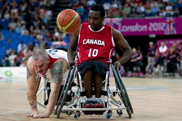 Abdi Dini battles for possession in a game versus Great Britain in the 2012 Paralympic Games in London.