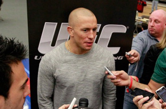 ATLANTA, GA - APRIL 19: Georges St-Pierre of Canada speaks to the media during UFC 145 open workouts at GSU Sports Arena on April 19, 2012.