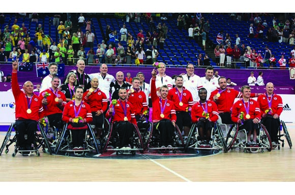 Canada's gold medal winning team salutes the crowd in London