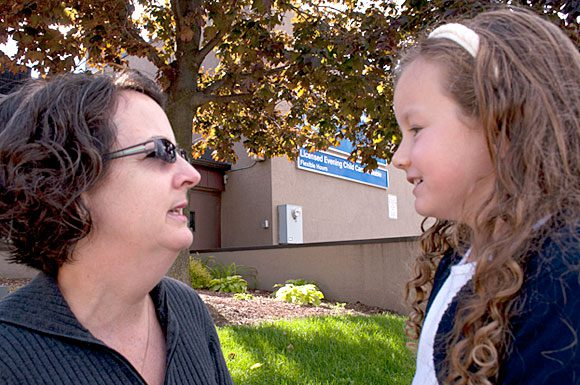 Mary Farrugia, left, says she hopes the Chinguacousy Evening Care Program stays open until she finds an alternative evening child care program for her daughter Skye. Peel regional council voted recently to close all 12 of the region's Learn.Play.Care child care centres, including Chinguacousy.
