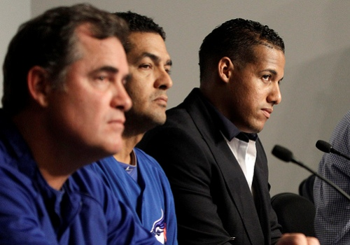 Yunel Escobar fields questions about his offensive eye black from reporters at Tuesday's press conference.