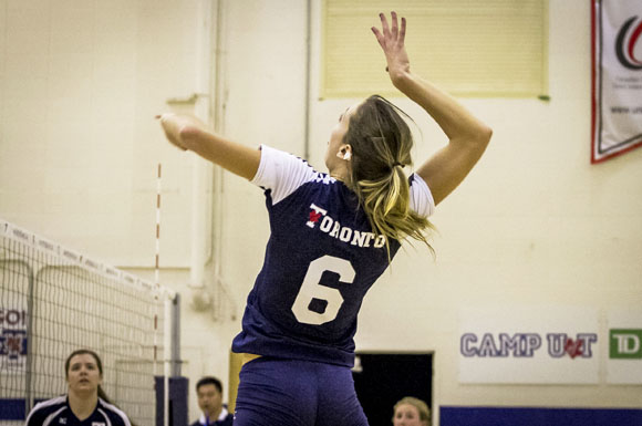 Alexandra Hudson goes up for the hit in the Varsity Blues game versus Western on Friday