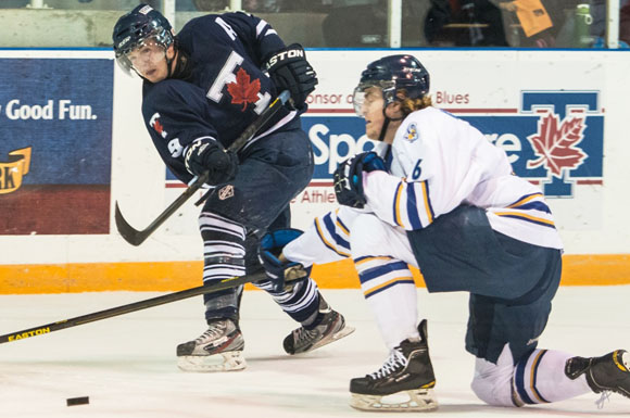 Toronto's Bobby Blake rifles a shot towards the net as a Ryerson defender attempts to get in the way.