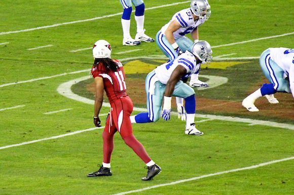 Cardinals quarterback Kevin Kolb will likely look to star wideout Larry Fitzgerald early and often with the team's top-two runningbacks out