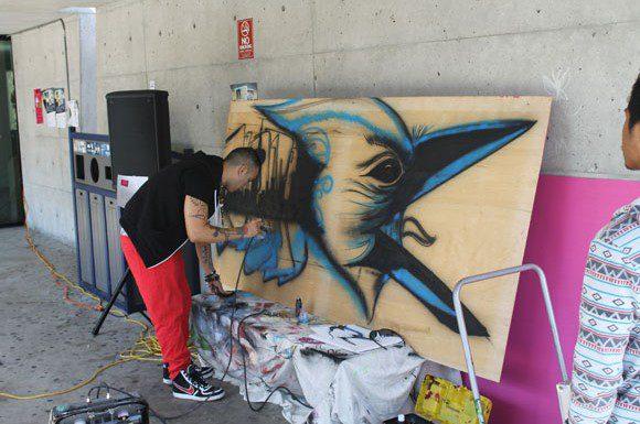 UTSC alumnus Miguel Pinzon creates a live graffiti performance at the fifth annual ARTSIDEOUT