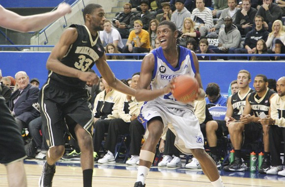 Juwon Grannum drives to the basket against Wake Forest in exhibition play
