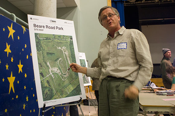 Kevin O'Connor, President of Friends of the Rouge Watershed, uses his pen to point out the topography of the Beare Road Landfill Park during a public meeting at Blessed Mother Teresa CSS in Scarborough.