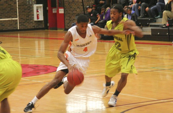 Xzennis Brereton drives to the basket during a Mohawk College exhibition victory