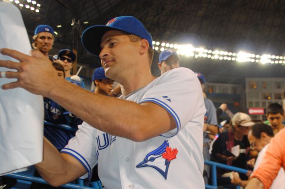 Omar Vizquel signs autographs for fans prior to his final game of his 23-year playing career.