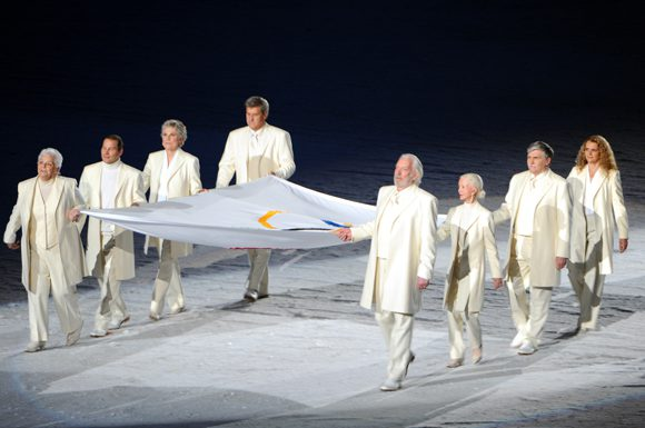 Barbara Ann Scott (third person from the right) is one of eight Canadians recognized and honoured to carry the Olympic flag during the Opening Ceremonies of the 2010 Vancouver Winter Olympics.