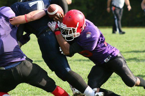 Black Scots defenceman forces a fumble from Laurier Blue Devils' quarterback