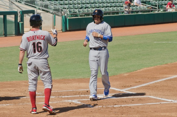 D-backs' Tyler Bortnick waits for Salt River Rafters' teammate Ryan Goins to cross the plate.