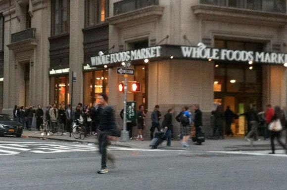 New Yorkers line up outside the Chelsea Whole Foods supermarket in New York City on Sunday evening to prepare ahead of Hurricane Sandy blowing into town.