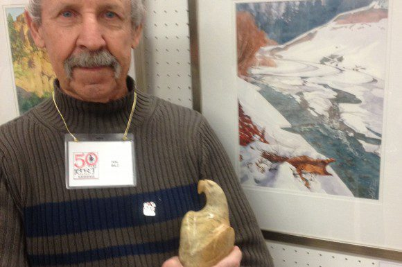 """Hal Bilz beside his award winning painting """"Rouge Fractured."""" Bilz is holding a sculpture given to the winner of the juror's choice at each fall show."""