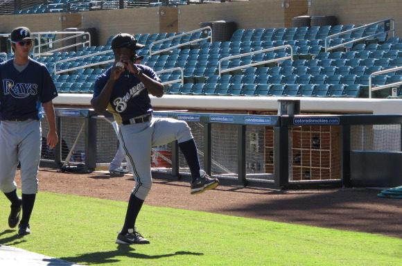 Darnell Coles pitches to the backstop, while Rays' prospect Hak-Ju Lee wonders why.