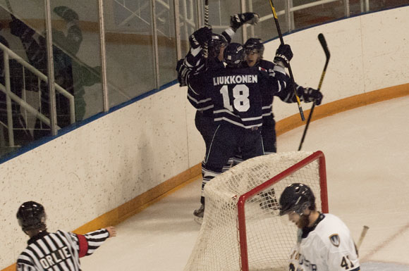 Varsity Blues forward Tyler Liukkonen celebrates with his teammates after a goal versus Windsor on Friday.