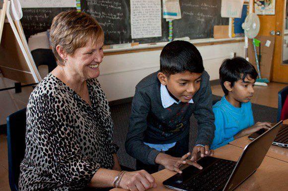 Mason Road Public School student Vaksan Kugenthiraja, 10, shows his principal Stacey Michener his personalized avatar greeting using Edmodo.com.