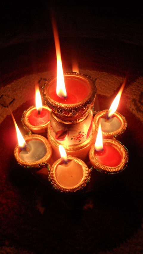 The Hindu/Indian traditional diya candle is lit for Diwali. It ...
