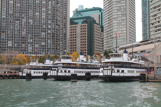 Toronto Island ferries, docked along the waterfront, are still serving passengers with regular runs across the harbour. Most have operated since the 1930s.