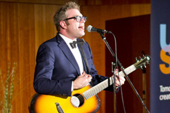 Steven Page performs one of his songs to illustrate the struggles he went through with depression.