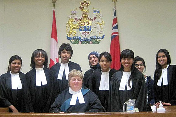 Sel' McCallum, third from left, and other students in an Ontario Justice Education Network French language program participate in a mock bail hearing at Flemingdon Park Neighbourhood Services in August.