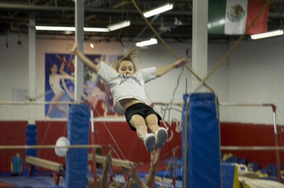 Lexie Buffan cradles out of a stunt with the Scarborough Titans junior cheerleaders.
