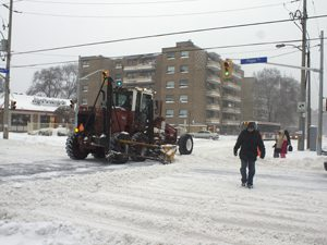 Pedestrians make their way through East York at Pape and Cosburn avenues Friday Feb.8, 2013 after first wave of snow ends.