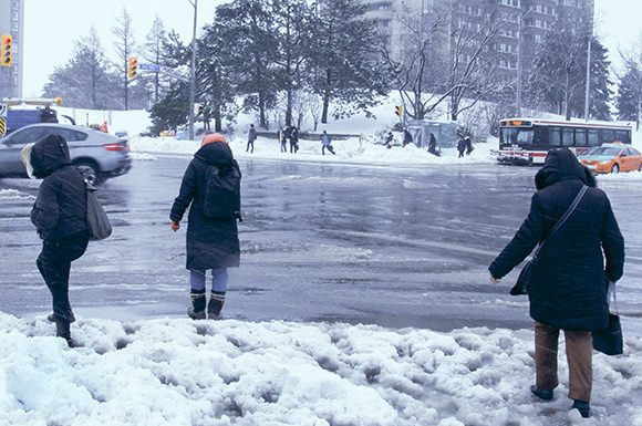 Pedestrians struggle through the heavy snow on Don Mills and Finch Avenue East