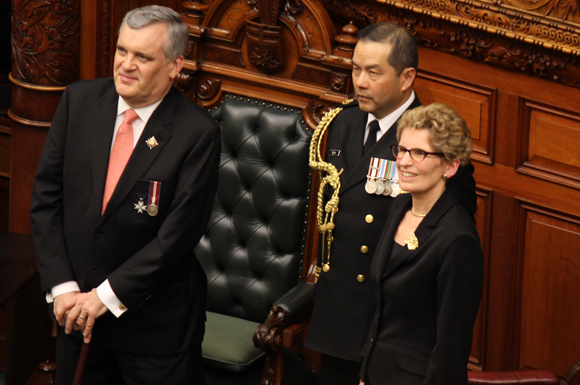 Kathleen Wynne (right) and Lieutenant Governor David Onley (left) on Monday swore in a larger Ontario cabinet.