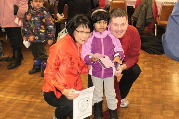 From left: MP Olivia Chow and Councillor Glenn De Baeremaeker pose with a little girl.