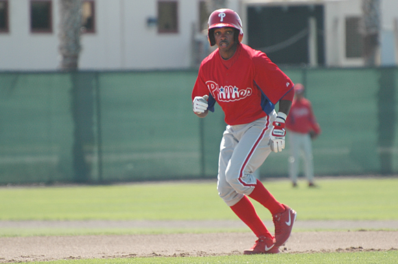 Phillies shortstop prospect Roman Quinn practices stealing bases at the club's Clearwater training centre.