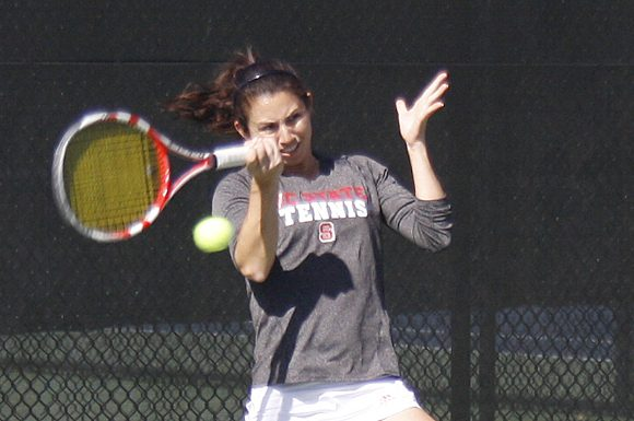 Chloe Smith and her doubles tennis partner Sophie Nelson helped the North Carolina Wolfpack womens' tennis team maintain their undefeated streak at 8-0.