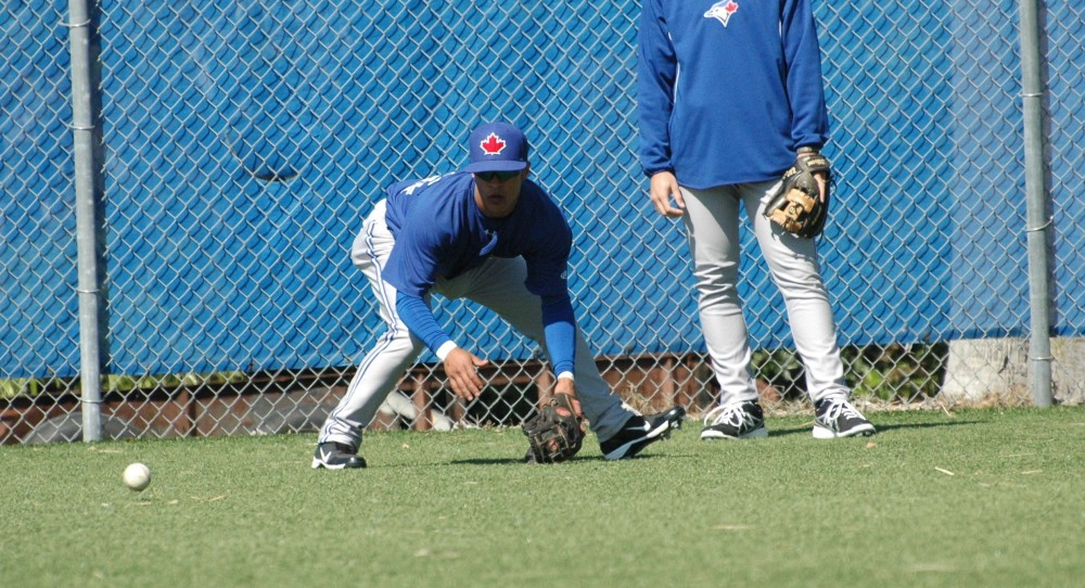 Shortstop Jorge Flores fields a ground ball at spring training for the Blue Jays in Dunedin, Florida.