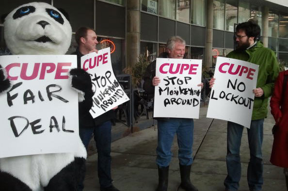 Zookeepers raise awareness about the potential lockout they are facing. From the left: Zoo worker in panda costume, Brandon Wyatt, Grant Ankenman and Matt Berridge.
