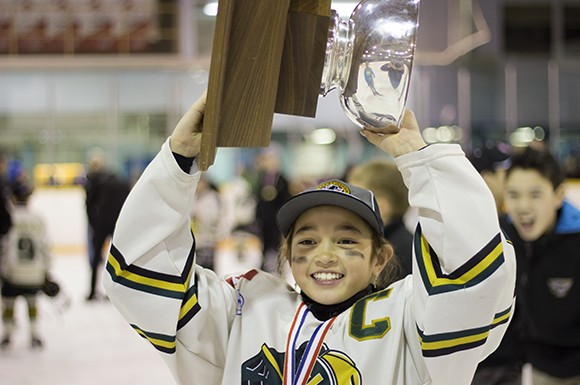 Nicole Gosling, London Jr. Knights captain, raises the cup following a 4 - 1 win against the Mississauga Braves