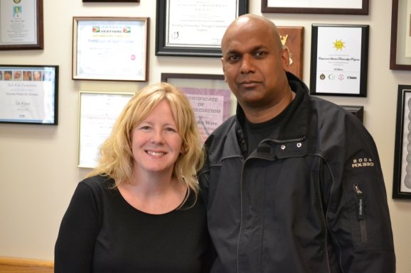 Constable Patricia Hung with 'Positive Ticket' recipient Rajiv Singh.
