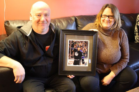 Rob and Mandy Toffoli hold a picture of Tyler taken when he scored his first NHL goal.