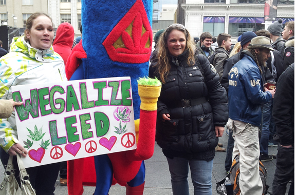These ladies happily take a snap shot with Benny the Bong during the 4/20 event at Yonge and Dundas Square.