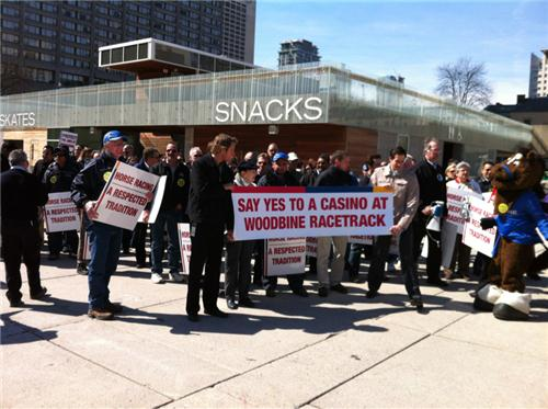 Pro casino workers from Woodbine Racetrack demonstrate outside Toronto City Hall Monday April 15, 2013