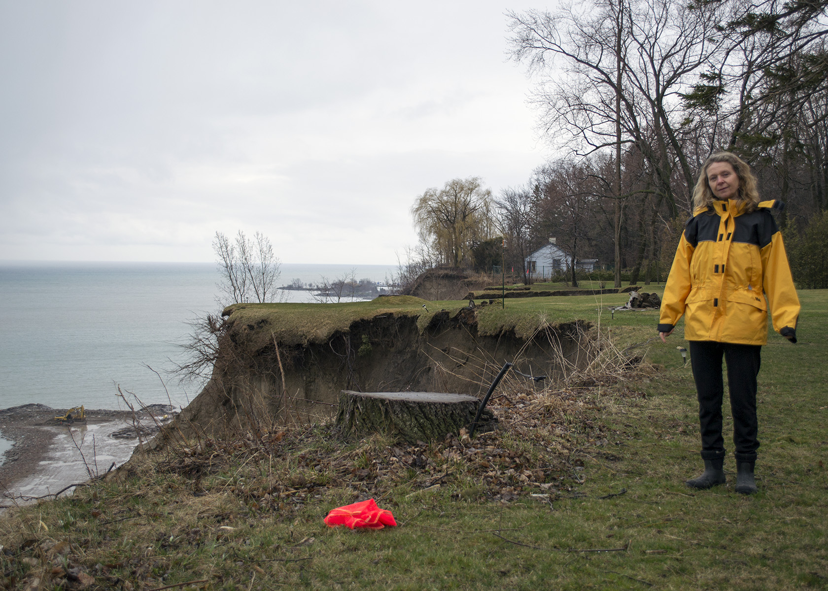 Meadowcliffe resident Susan Scinocca shows the extent of cliff erosion where a tree used to stand.