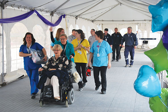 Bridgepoint staff help patient Jean Heap move to the new hospital (photo by Jennifer Specht/Bridgepoint Active Healthcare)
