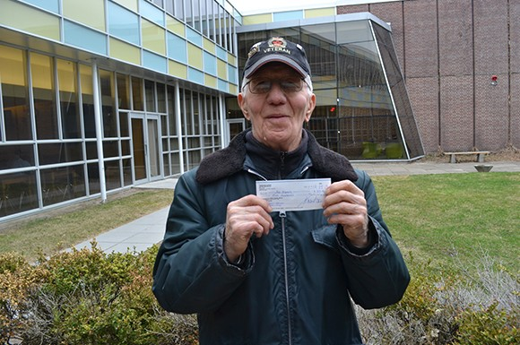 Jack Aldred with a cheque from his friends at Centennial College's East York campus — in support of his new, self-published memoir. (Josh Genereux/Toronto Observer)