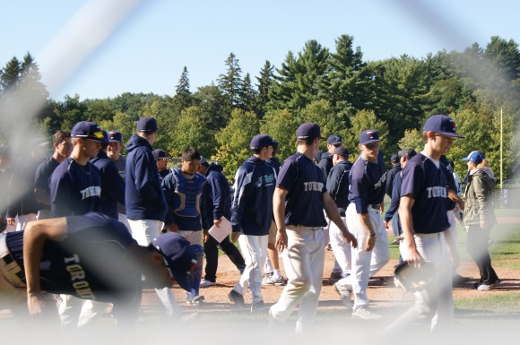 The Varsity Blues walk off the diamond after a blowout victory over the visiting Ryerson Rams. Ryan Horne/Toronto Observer