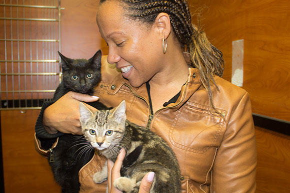 Kimitra Lovell and the two kittens that she adopted on Saturday, September 15 from Petsmart's National Adoption Weekend.