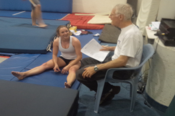 Rosie MacLennan and coach Dave Ross discuss her training at Skyriders Trampoline Place. (Curtis Ng/Toronto Observer)